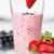 close up of milkshake decorated with strawberry stock photo © dolgachov