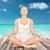 woman meditating in yoga lotus pose stock photo © dolgachov