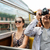 smiling couple with camera traveling by tour bus stock photo © dolgachov