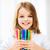 girl showing colorful felt tip pens stock photo © dolgachov