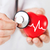 doctor hands holding red heart and stethoscope stock photo © dolgachov