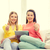 two smiling teenage girls with tablet pc at home stock photo © dolgachov