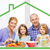 boldog · mosolyog · család · mögött · konyhaasztal · lány - stock fotó © dolgachov