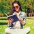 diák · olvas · tankönyv · ül · park · természet - stock fotó © dolgachov