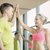smiling man and woman making high five in gym stock photo © dolgachov