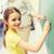 weinig · glimlachend · schoolmeisje · schrijven · krijt · boord - stockfoto © dolgachov