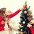 smiling family decorating christmas tree at home stock photo © dolgachov