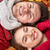 close up of smiling couple lying on autumn leaves stock photo © dolgachov
