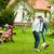 barátok · játszik · futball · égbolt · sport · természet - stock fotó © dolgachov