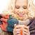 woman with red mug stock photo © dolgachov