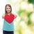 smiling little girl giving red heart stock photo © dolgachov
