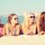 группа · улыбаясь · женщины · Солнцезащитные · очки · пляж · Летние · каникулы - Сток-фото © dolgachov