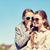 happy girl whispering secret to her friends ear stock photo © dolgachov