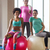 group of smiling women with exercise balls in gym stock photo © dolgachov