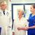 medics and senior patient woman at hospital stock photo © dolgachov