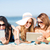 girls with tablet pc on the beach stock photo © dolgachov