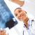 gülen · kadın · doktor · bakıyor · xray · sağlık - stok fotoğraf © dolgachov