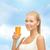 glimlachende · vrouw · glas · sinaasappelsap · voedsel · gezondheidszorg - stockfoto © dolgachov