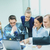 jovem · concentrado · homens · colegas · escritório · usando · laptop - foto stock © dolgachov