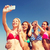 csoport · mosolyog · barátok · készít · tengerpart · barátság - stock fotó © dolgachov