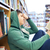 student boy or young man reading book in library stock photo © dolgachov