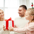 happy family at home with christmas gift box stock photo © dolgachov