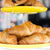 close up of croissants and buns on cake stand stock photo © dolgachov