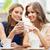 fiatal · nők · okostelefon · kávé · kávézó · technológia · életstílus - stock fotó © dolgachov