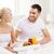 happy couple having breakfast in bed at home stock photo © dolgachov