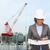 businesswoman in white helmet with blueprint stock photo © dolgachov