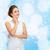 smiling woman in white dress with diamond ring stock photo © dolgachov