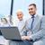 mosolyog · üzletemberek · laptop · kint · üzlet · technológia - stock fotó © dolgachov