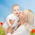 happy mother with baby over natural background stock photo © dolgachov