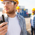 close up of builder in hardhat with walkie talkie stock photo © dolgachov