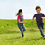 happy little boy and girl running outdoors stock photo © dolgachov