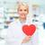 kadın · kırmızı · kat · kalp · şekli · genç - stok fotoğraf © dolgachov
