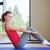 smiling woman doing exercises on mat in gym stock photo © dolgachov