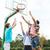 group of happy teenage friends playing basketball stock photo © dolgachov