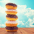 close up of glazed donuts pile over blue sky stock photo © dolgachov