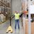 man with loader and clipboard at warehouse stock photo © dolgachov