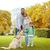 giovani · famiglia · esterna · piedi · parco · cane - foto d'archivio © dolgachov