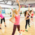 group of smiling women stretching in the gym stock photo © dolgachov