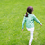 little girl walking along summer green meadow stock photo © dolgachov