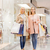 happy young women with shopping bags in mall stock photo © dolgachov
