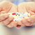 vrouw · hand · pillen · tablet · vrouwelijke - stockfoto © dolgachov