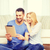 smiling happy couple with tablet pc at home stock photo © dolgachov