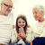 smiling family with smartphone at home stock photo © dolgachov