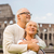 happy senior couple over coliseum in rome italy stock photo © dolgachov