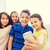 group of school kids taking selfie with smartphone stock photo © dolgachov