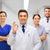 group of medics at hospital showing ok hand sign stock photo © dolgachov